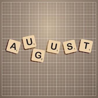 Августовский месяц прописными буквами с концепцией блока скребков