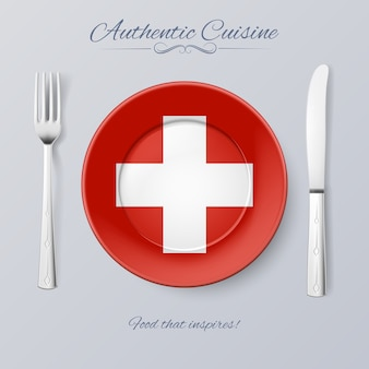 スイスの本格的な料理。スイス国旗とカトラリーのプレート