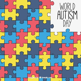 Autism day background with colorful puzzle pieces