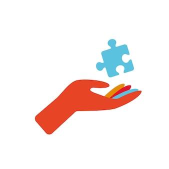 自閉症のシンボルパズルの詳細を保持している手子供たちのパズル