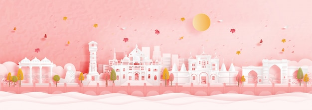 Autumn in ahmedabad, india with falling maple leaves and world famous landmarks in paper cut style
