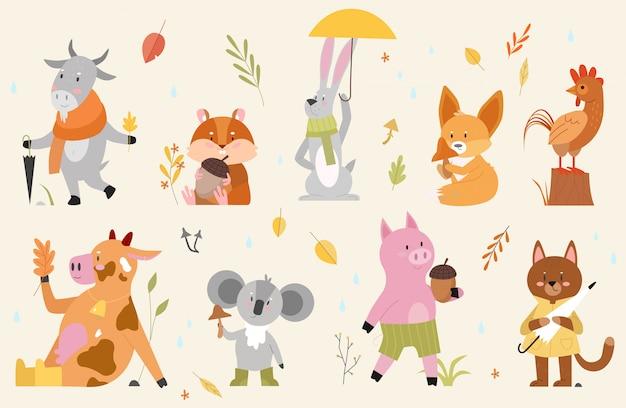 秋の動物イラストセット。漫画の手描きの森で秋のシーズンを楽しんでいるかわいい動物キャラクターと秋の森コレクション、面白い牛山羊鶏オンドリハムスター豚猫