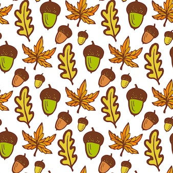 Autumn background. seamless pattern with acorns and maple, oak leaves. hand drawn vector
