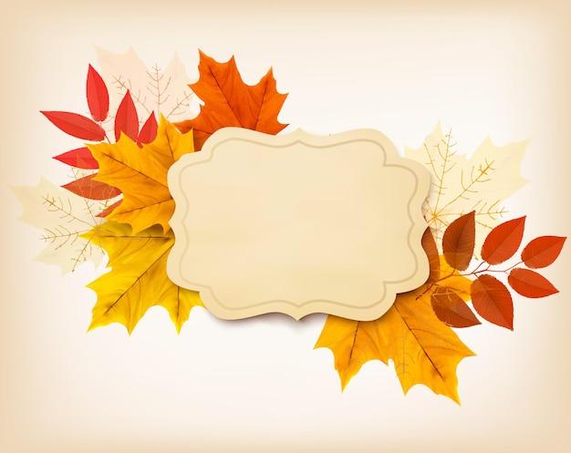 ヴィンテージカードと色とりどりの葉と秋の背景。