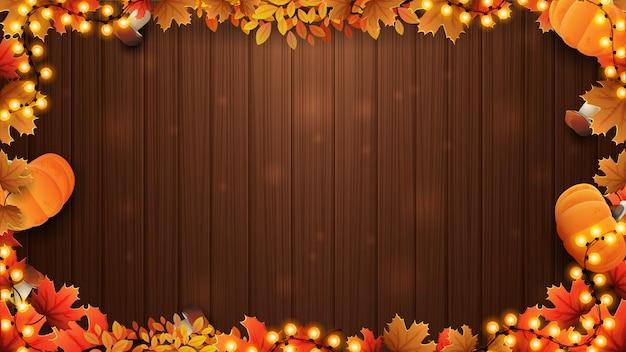 秋の葉で作られたフレームと秋の背景