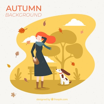 Autumn background with girl and dog