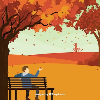 Autumn background with person in the park