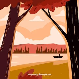 木、ボート、湖がある秋の背景