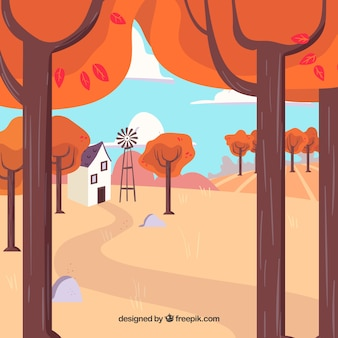 Autumn background with trees, house and windmill