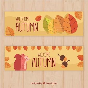 Banner d'autunno con foglie, ghiande e scoiattolo