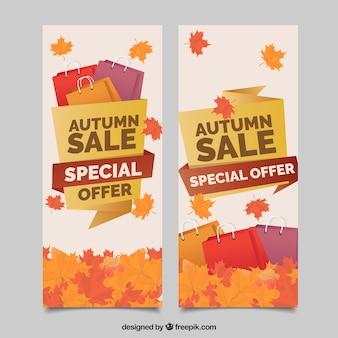 Banner d'autunno con sacchetti e fogli di shopping
