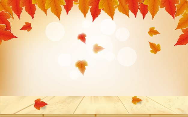 Autumn bokeh background with fallen leaves on the table