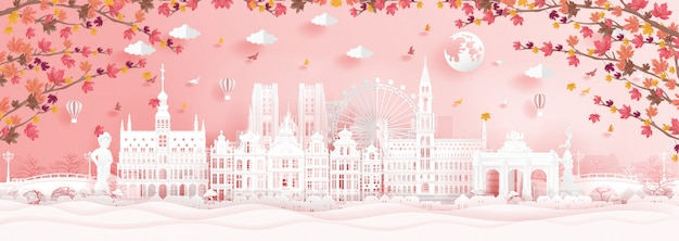 Autumn in brussels, belgium with falling maple leaves and world famous landmarks