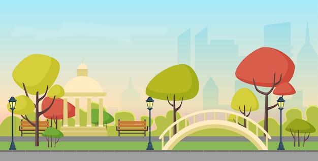 Осенний городской общественный парк на фоне небоскребов современного города