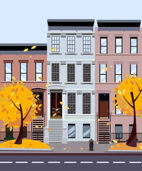 Autumn city street. three-four-story houses. street cityscape. day city landscape with autumn trees in the foreground