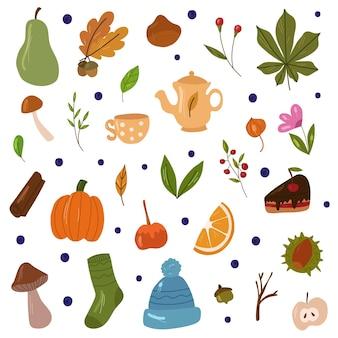 秋の居心地の良いデザイン要素暖かい靴下と帽子の葉とflowerstea