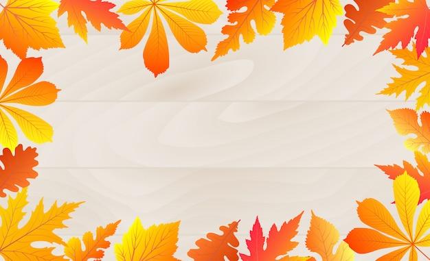Осенние падающие листья кадр на деревянной текстуре