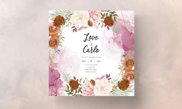 バラと松の花と秋の花の結婚式の招待カード