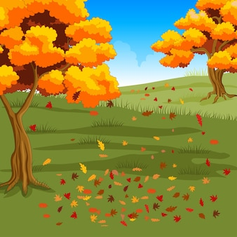 葉が落ちる秋の森の背景