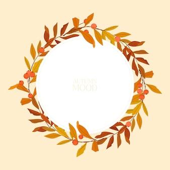 色とりどりの葉と秋のフレーム。自然の花輪。