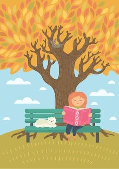 木の下の外で本を読んで秋の女の子