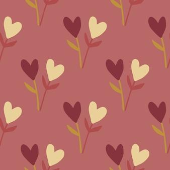 Осенние сердца и веточки бесшовные модели. мягкий бордовый фон с элементами желтого и темного сердца.