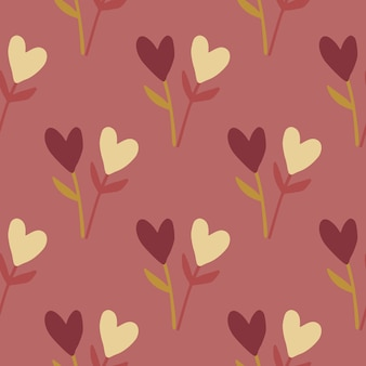Autumn hearts and twigs seamless pattern. soft burgundy background with yellow and dark heart elements.