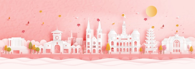 Autumn in ho chi minh city, vietnam with falling leaves and world famous landmarks in paper cut style vector illustration
