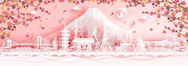 Осень в токио, япония с падающими листьями клена и всемирно известными достопримечательностями