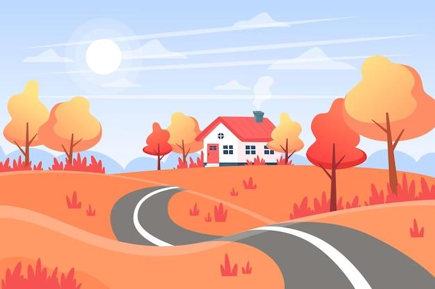 遠くに道路、丘、家のある秋の風景