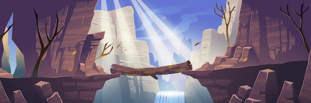川の滝と裸の木の上の山の丸太橋と秋の風景