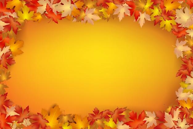 オレンジ色の背景に落ちる秋の葉