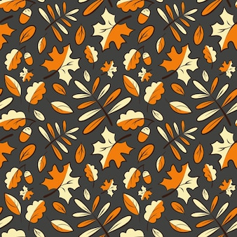 Autumn leaves on a dark gray background. seamless pattern.
