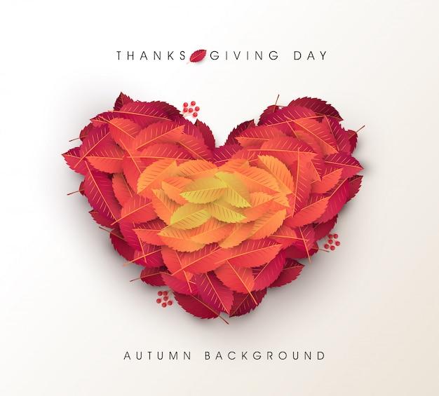 秋の葉のハート形の背景。感謝祭の日