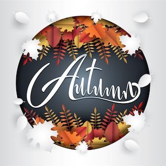 Autumn lettering on fallen leaves