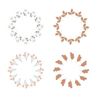 白い背景の上の秋のミニマルな花輪。赤いベリーと葉で枝分かれします。デザインはがきの円形要素のセット
