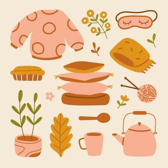 秋の気分要素。秋の漫画hygge居心地の良いセーター、葉、花、カボチャ、パイ、睡眠アイマスク、スカーフ、ケトル、マグカップ、鉢植えの植物、スタッククッション、糸のボールと針のイラストセット。