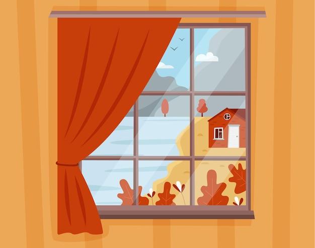 居心地の良い家と湖のある窓からの秋の山の風景の眺め