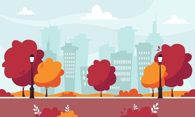 街灯と茂みのある秋の公園