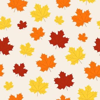 秋のパターン。ベージュの背景にシームレスな秋のカエデの葉。季節の壁紙。