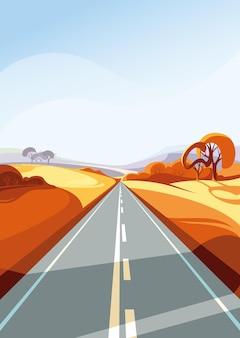 水平線に広がる秋の道。縦向きの屋外シーン。