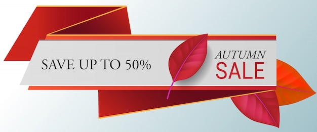 Autumn sale, save up to fifty percent lettering with red leaves.