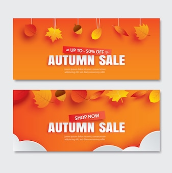 Осенняя распродажа с листьями в стиле бумажного искусства на оранжевом фоне.