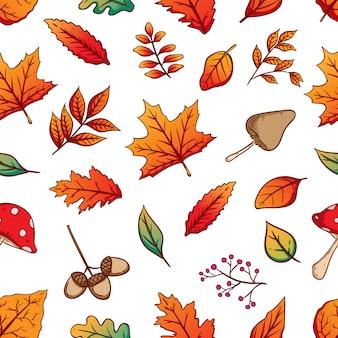 白地にカラフルな紅葉と秋のシームレスパターン