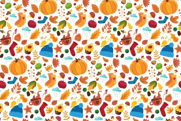 Autumn seamless pattern with cute fall symbols ornament: knitted socks, hat, pumpkin, tea cups