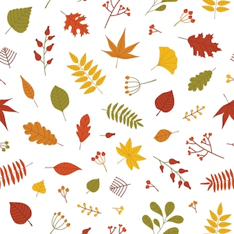 Autumn seamless pattern with fallen tree leaves and sprigs with berries