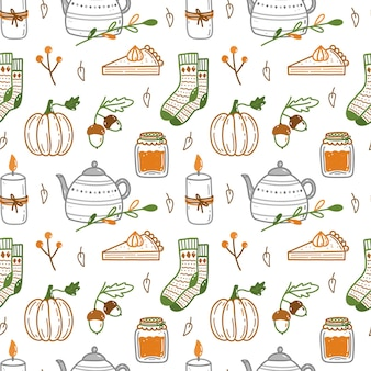 Autumn seamless pattern with pumpkins acorns warm socks candles cute teapot and other