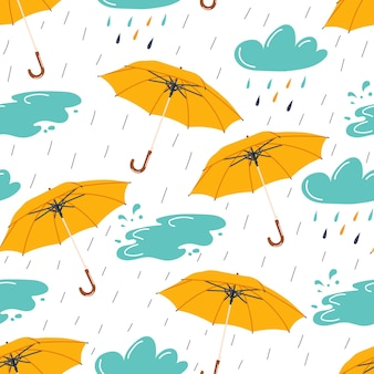 Autumn seamless pattern with rainy weather elements umbrellaclouds and puddle