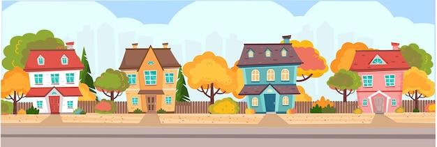 町の秋の季節秋には木々や茂みに囲まれた色とりどりのコテージ