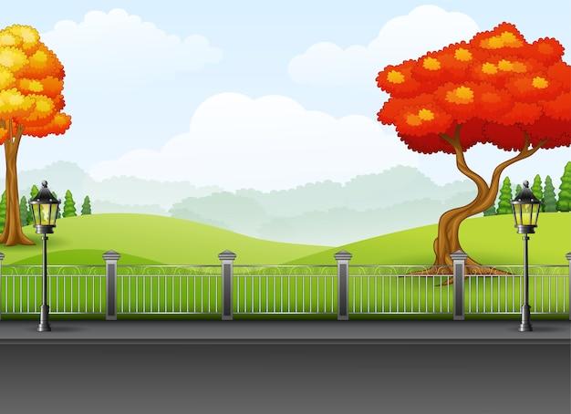 Осенний сезон с дорожным ландшафтом